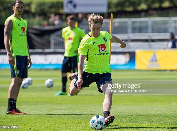 Sweden's forward and team captain Zlatan Ibrahimovic observes as his teammate midfielder Emil Forsberg during a training session in Bastad Sweden on...