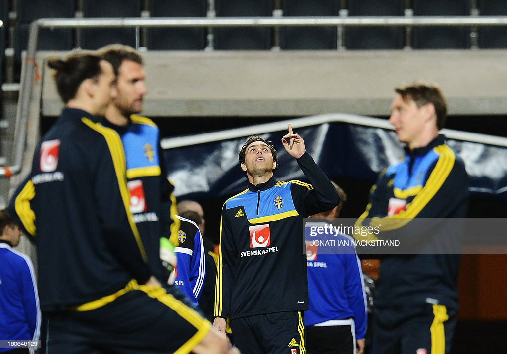 Sweden's forward Johan Elmander (C) takes part in a training session of the Swedish national football team at the 'Friends Arena' in Stockholm, Sweden, on February 4, 2013 two days before the FIFA World Cup 2014 friendly match Sweden vs Argentina.