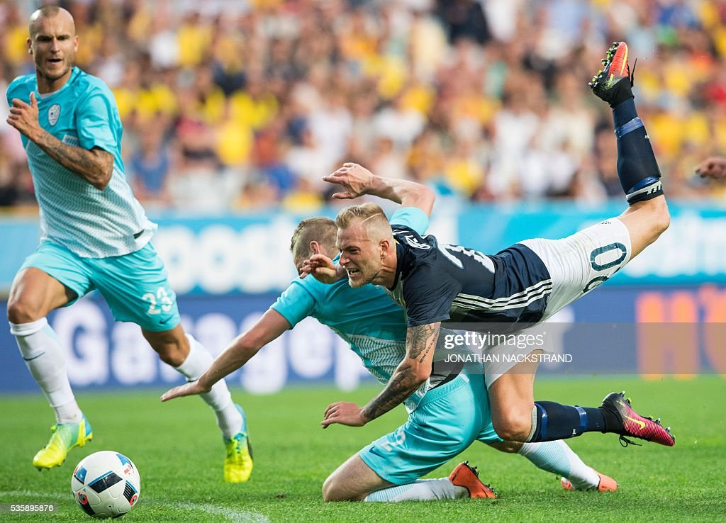 Sweden's forward John Guidetti (R) vies with Slovenia's defender Nejc Skubic during the friendly football match between Sweden and Slovenia at Swedbank stadium in Malmo on May 30, 2016. / AFP / JONATHAN