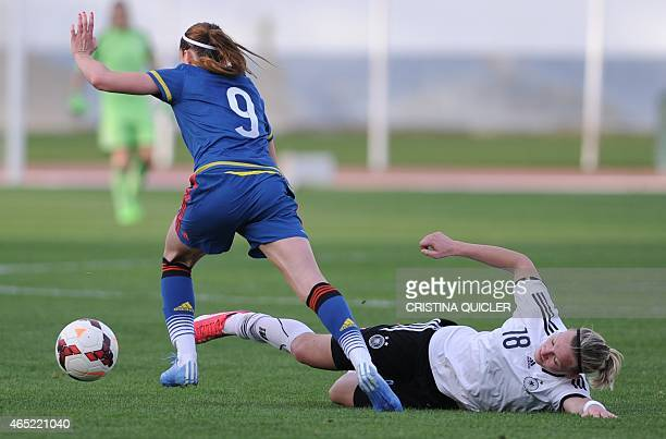 Sweden's forward Kosovare Asllani vies with Germany's forward Alexandra Popp during the match Germany vs Sweden at the Estadio Municipal in Vila Real...