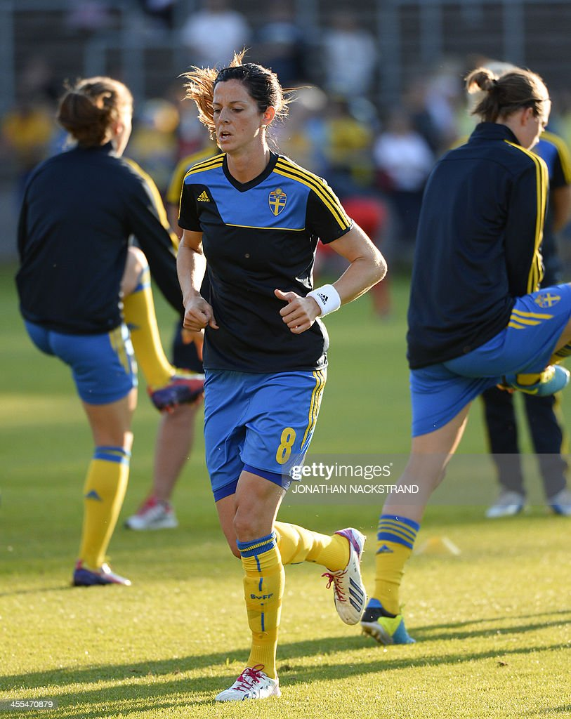 Sweden's forward Lotta Schelin warm up prior to the UEFA Women's European Championship Euro 2013 group A football match Sweden vs Italy on July 16, 2013 in Halmstad, Sweden.AFP PHOTO/JONATHAN NACKSTRAND
