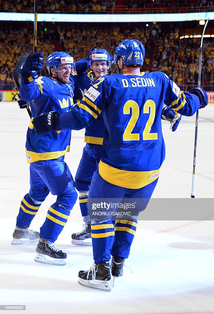 Sweden's forward Loui Eriksson (C), forward Henrik Sedin (L) and forward Daniel Sedin celebrate after scoring a goal during the semi final match Finland vs Sweden of the IIHF International Ice Hockey World Championship at Globe Arena in Stockholm on May 18, 2013. AFP PHOTO / ANDREJ ISAKOVIC RESTRICTED TO EDITORIAL USE