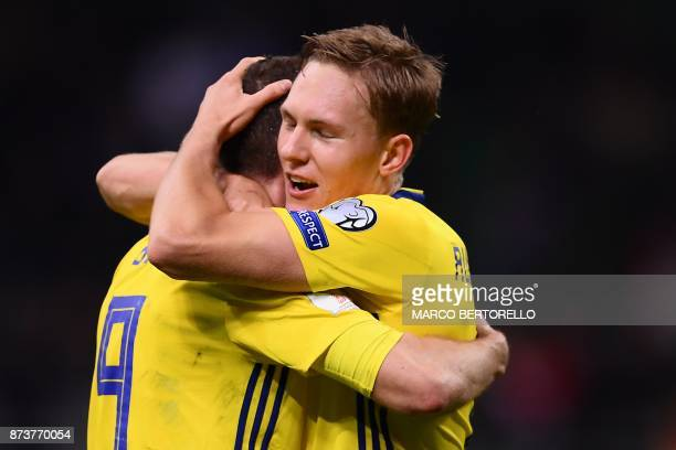 Sweden's forward Marcus Berg and Sweden's midfielder Markus Rohden celebrate at the end of the FIFA World Cup 2018 qualification football match...