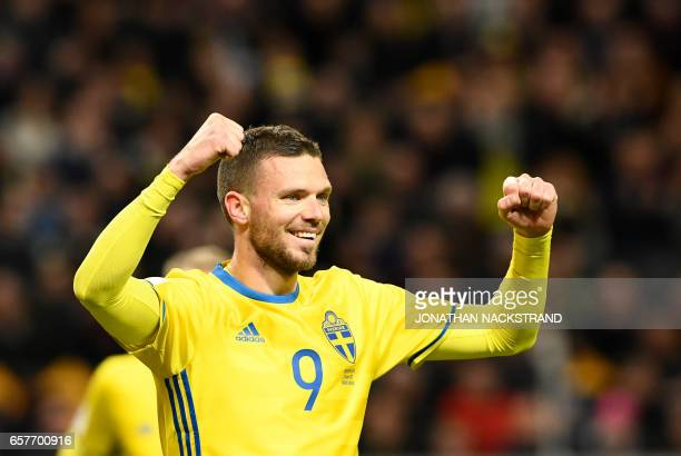 Sweden's forward Marcus Berg celebrates after scoring a goal during the FIFA World Cup 2018 qualification football match between Sweden and Belarus...