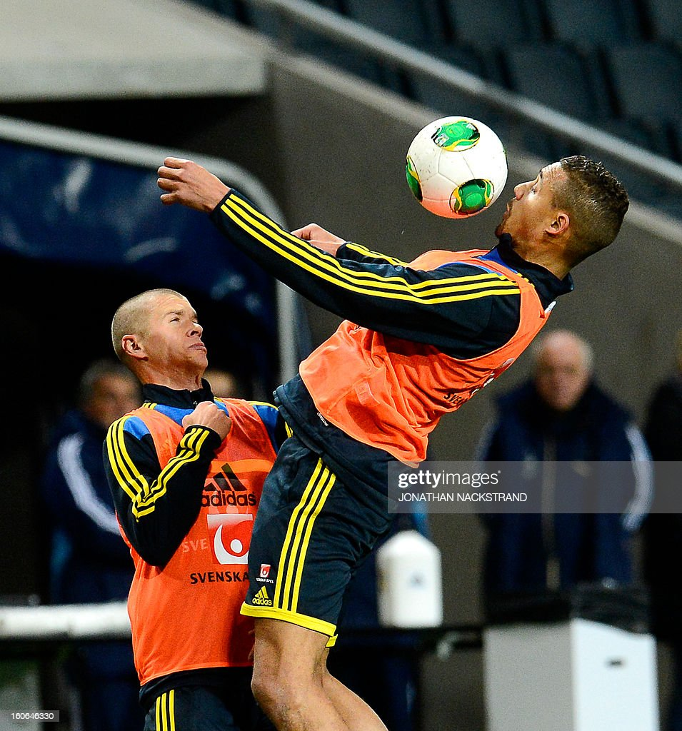 Sweden's forward Mathias Ranegie (R) and midfielder Samuel Holmen take part in a training session of the Swedish national football team at the 'Friends Arena' in Stockholm, Sweden, on February 4, 2013 two days before the FIFA World Cup 2014 friendly match Sweden vs Argentina.