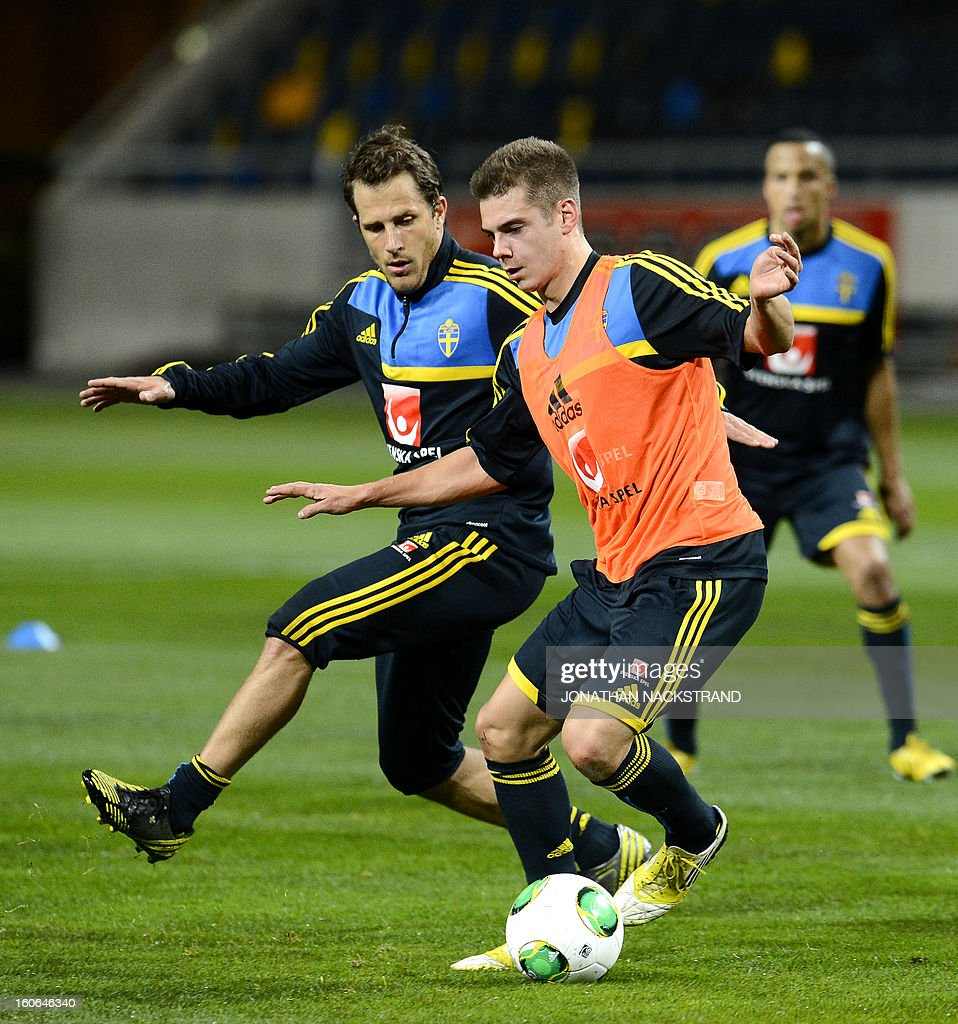 Sweden's forward Tobias Hysen (L) and midfielder Alexander Kacaniklic take part in a training session of the Swedish national football team at the 'Friends Arena' in Stockholm, Sweden, on February 4, 2013 two days before the FIFA World Cup 2014 friendly match Sweden vs Argentina. AFP PHOTO/JONATHAN NACKSTRAND