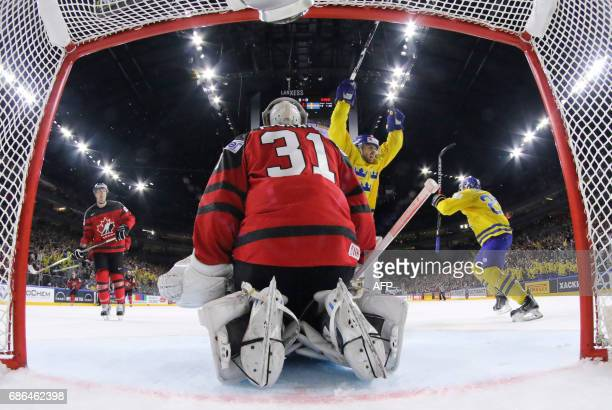 Sweden´s forward William Nylander and team mates celebrate putting the puck behind Canada´s goalkeeper Calvin Pickard during the IIHF Ice Hockey...
