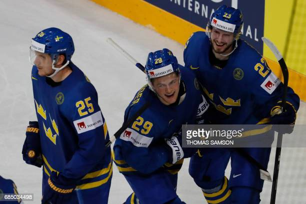 Sweden's forward William Nylander is congratulated by teammates after scoring a goal during the IIHF Men's World Championship quarter final ice...