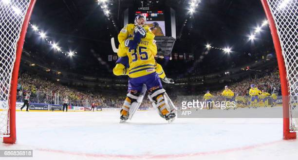 Sweden´s forward William Nylander jumps on Sweden´s goalkeeper Henrik Lundqvist in celebrations after winning the penalty shot out the IIHF Ice...