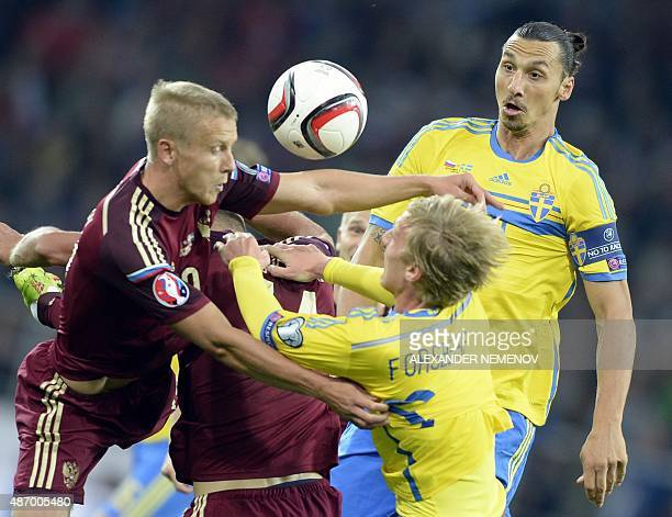 Sweden's forward Zlatan Ibrahimovic and Sweden's midfielder Emil Forsberg fight for the ball with Russia's midfielder Alan Dzagoev during their UEFA...