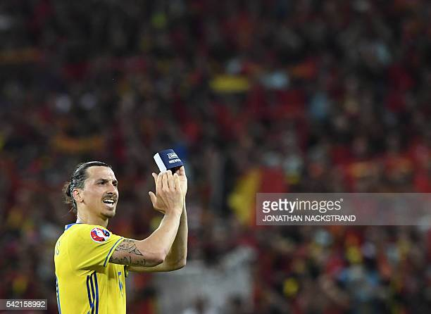 Sweden's forward Zlatan Ibrahimovic applauds to acknowledge the spectators at the end of the Euro 2016 group E football match between Sweden and...