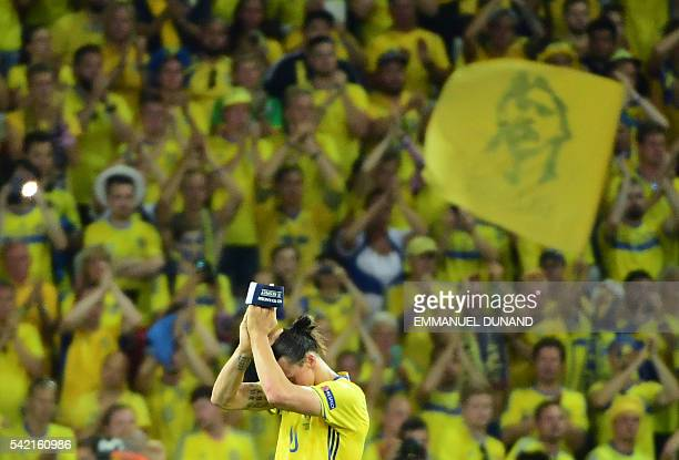 TOPSHOT Sweden's forward Zlatan Ibrahimovic applauds to acknowledge the spectators at the end of the Euro 2016 group E football match between Sweden...