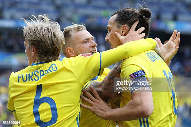 Sweden's forward Zlatan Ibrahimovic celebrates a goal with Sweden's forward John Guidetti and Sweden's midfielder Emil Forsberg during the Euro 2016...