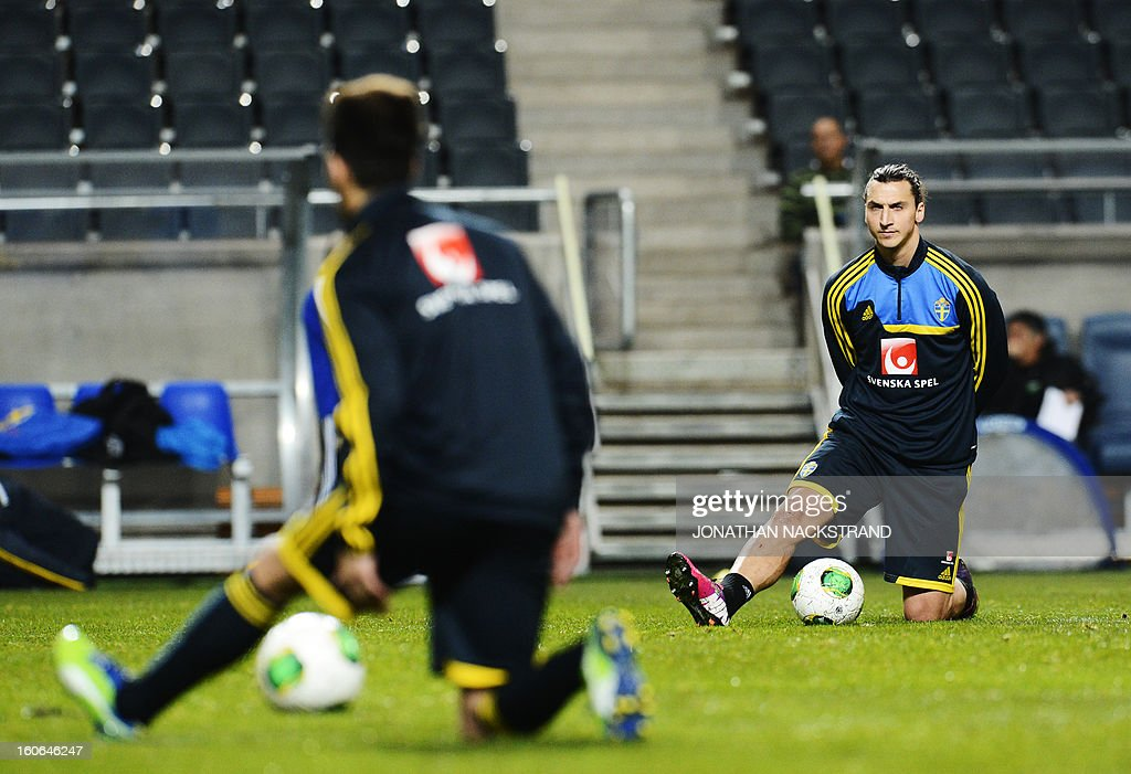 Sweden's forward Zlatan Ibrahimovic (R) takes part in a training session of the Swedish national football team at the 'Friends Arena' in Stockholm, Sweden, on February 4, 2013 two days before the FIFA World Cup 2014 friendly match Sweden vs Argentina.