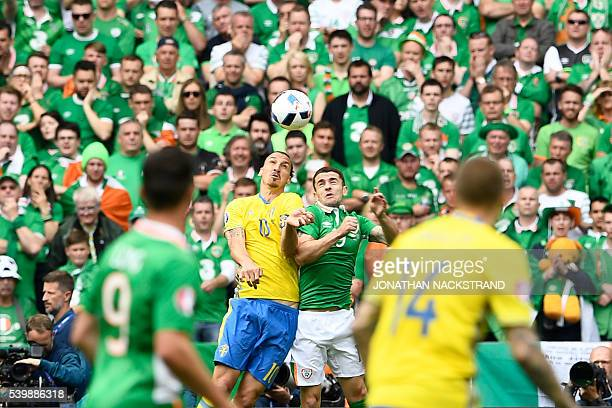 TOPSHOT Sweden's forward Zlatan Ibrahimovic vies for the ball with Ireland's forward Shane Long during the Euro 2016 group E football match between...