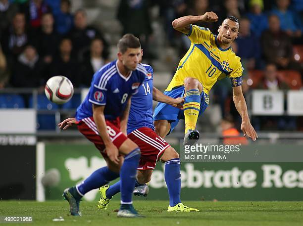Swedens forward Zlatan Ibrahimovic vies with Liechtensteins defenders Sandro Wieser and Yves Oehri during the Euro 2016 Group G qualifying football...