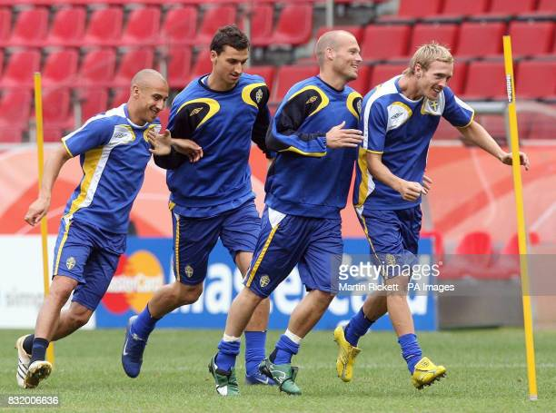 Sweden's Fredrik Larsson Zlatan Ibrahimovic Fredrik Ljungberg and Christian Wilhelmsson during a training session at FIFA World Cup Stadium Cologne...