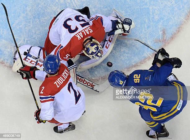 Sweden's Gabriel Landeskog tries to score against Czech Republic's goalkeeper Alexander Salak and Czech Republic's Marek Zidlicky during the Men's...
