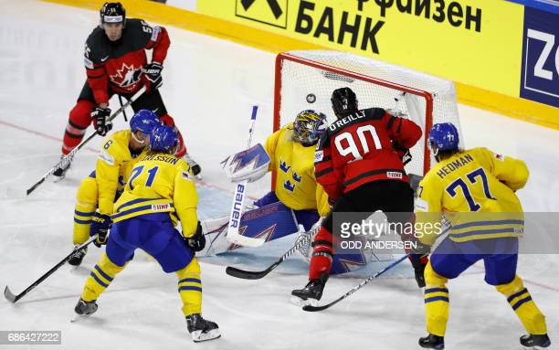 Sweden's goalie Henrik Lundqvist misses a shot from Canada's Ryan O' Reilly during the IIHF Men's World Championship Ice Hockey final game match...