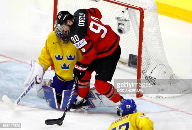 Sweden's goalie Henrik Lundqvist vies with Canada's Ryan O' Reilly during the IIHF Men's World Championship Ice Hockey final game match between...
