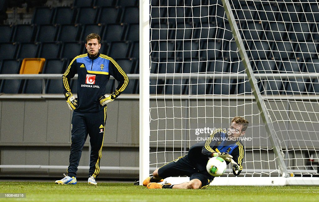 Sweden's Goalkeeper Andreas Isaksson (R) takes part in a training session of the Swedish national football team at the 'Friends Arena' in Stockholm, Sweden, on February 4, 2013 two days before the FIFA World Cup 2014 friendly match Sweden vs Argentina.