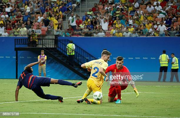 Sweden's goalkeeper Andreas Linde and defender Adam Lundqvist block Colombia's player Harold Preciado's attempt to goal during the Rio 2016 Olympic...