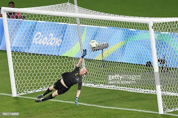 Sweden's goalkeeper Hedvig Lindahl fails to stop the ball during the Rio 2016 Olympic Games women's football Gold medal match at the Maracana stadium...