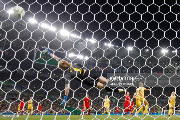 Sweden's goalkeeper Hedvig Lindahl fails to stop the ball scored by Germany's striker Dzsenifer Marozsan during the Rio 2016 Olympic Games women's...