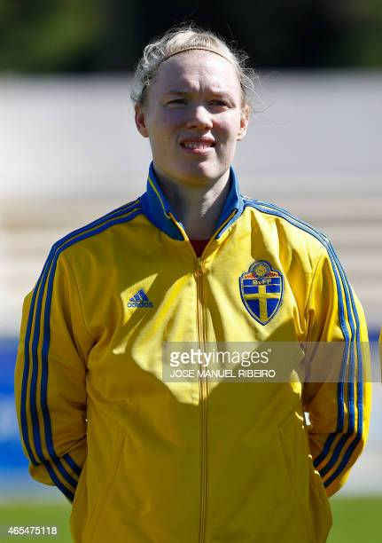 Sweden's goalkeeper Hedvig Lindahl listens to the national anthem before the Algarve Cup football match Sweden vs Brazil at the Estadio Municipal in...