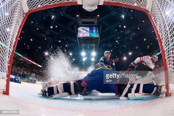 Sweden's goalkeeper Henrik Lundqvist is in action during the IIHF Men's World Championship quarter final ice hockey match Sweden vs Switzerland on...