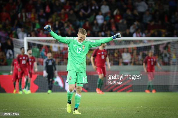 Swedens goalkeeper KarlJohan Johnsoon celebrating a goal during the FIFA 2018 World Cup friendly match between Portugal v Sweden at Estadio dos...