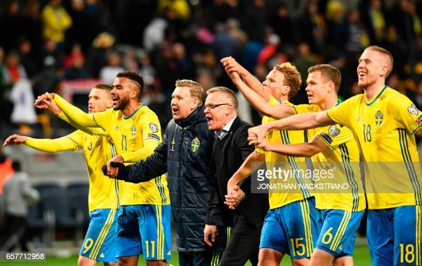 Sweden's head coach Janne Andersson and his players celebrate their win after the FIFA World Cup 2018 qualification football match between Sweden and...