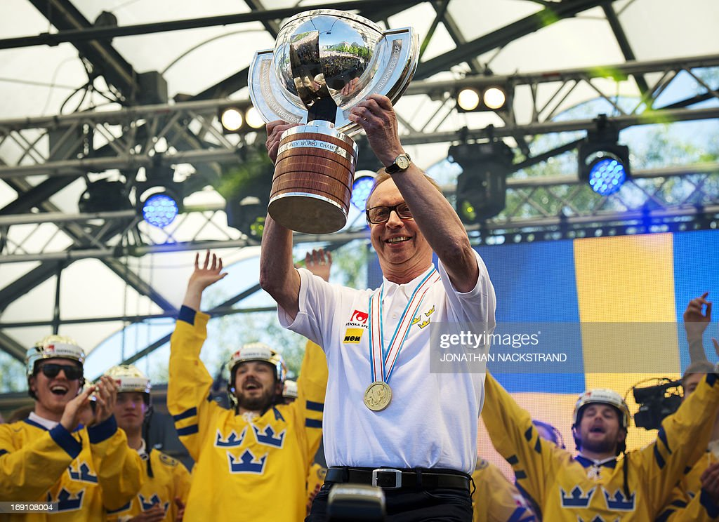 Sweden's head coach Par Marts raises the trophy during a victory celebration a day after winning the 2013 IIHF Ice Hockey World Championship, on May 20, 2013 in Stockholm.