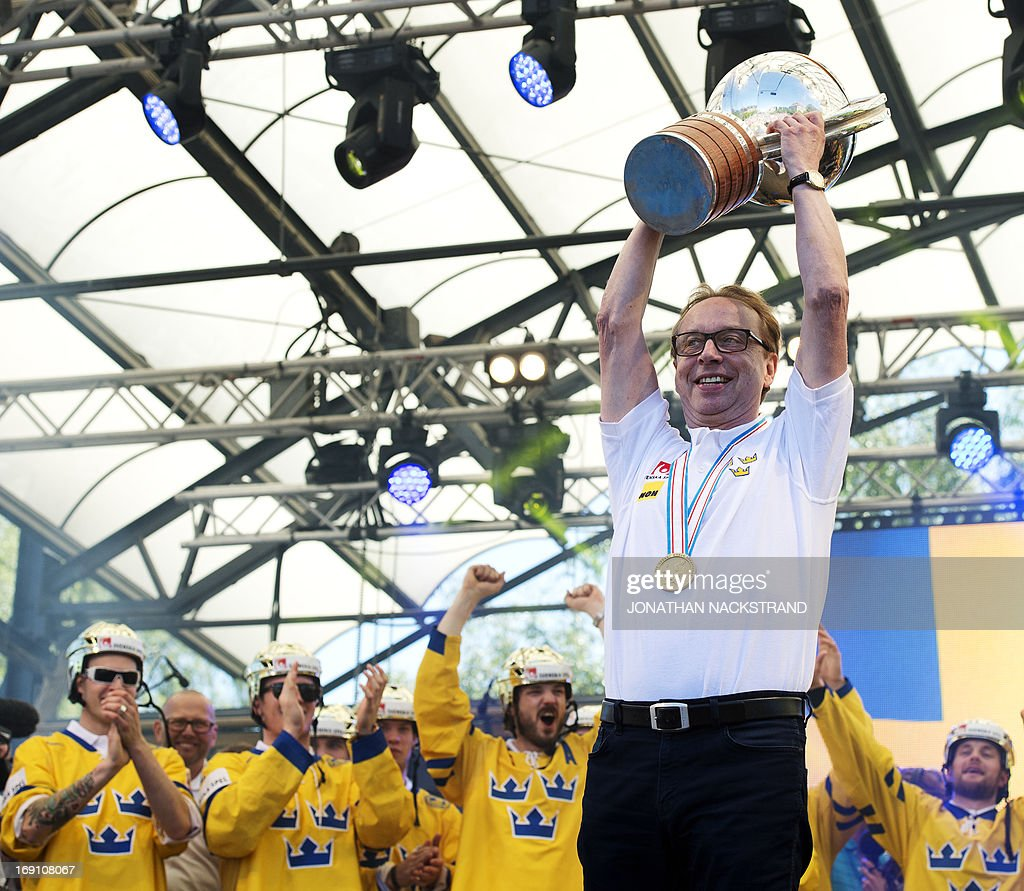 Sweden's head coach Par Marts raises the trophy during a victory celebration a day after winning the 2013 IIHF Ice Hockey World Championship, on May 20, 2013 in Stockholm. AFP PHOTO/JONATHAN NACKSTRAND