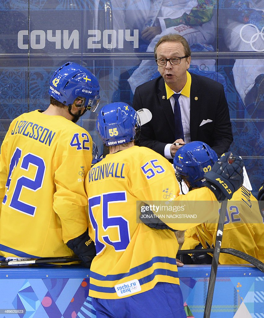 Sweden's head coach Par Marts speaks to his players after the Men's Ice Hockey Group C match Sweden vs Latvia at the Shayba Arena during the Sochi Winter Olympics on February 15, 2014.