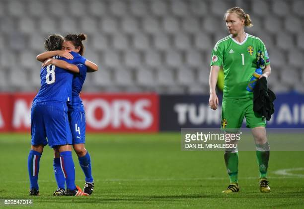 Sweden's Hedvig Lindahl looks on as Italy's Elena Linari and Daniela Stracchi celebrate after winning the UEFA Women's Euro 2017 football match...