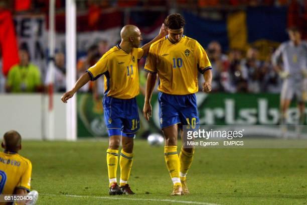Sweden's Henrik Larsson consoles Zlatan Ibrahimovic