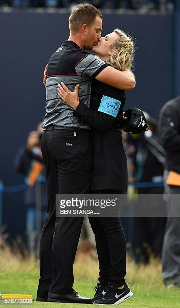 Sweden's Henrik Stenson kisses his wife Emma on the 18th green after his final round 63 to win the Championship on day four of the 2016 British Open...