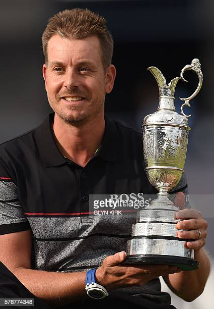 Sweden's Henrik Stenson poses for pictures with the Claret Jug the trophy for the Champion golfer of the year after winning the 2016 British Open...