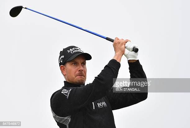 Sweden's Henrik Stenson watches his shot from the 14th tee during his second round on day two of the 2016 British Open Golf Championship at Royal...