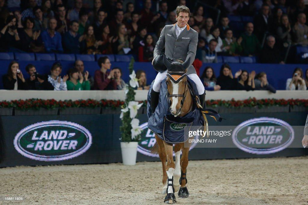 Sweden's Henrik Von Eckermann riding Gotha celebrates after winning the 'Memorial Eric Wauters' equestrian Rolex FEI World Cup Jumping competition, in Mechelen, on December 30, 2012.
