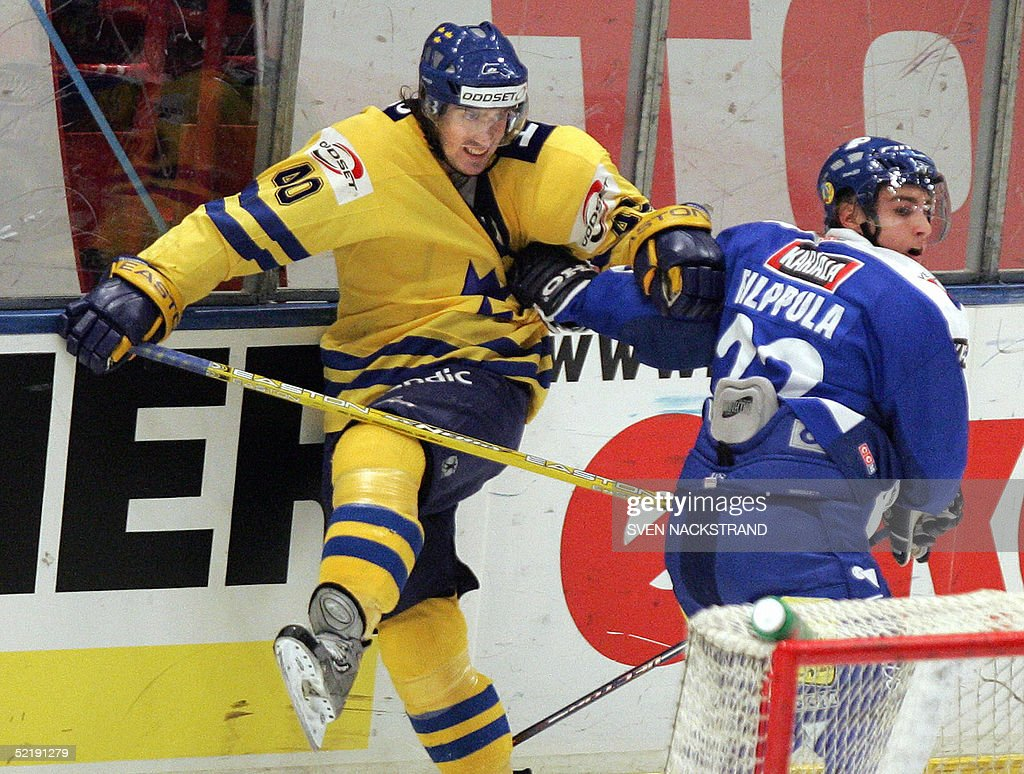 Sweden's Henrik Zetterberg who plays with Detroit Red Wings in the NHL is pushed by Finland's Valteri Filippula at the Sweden Hockey Games in...