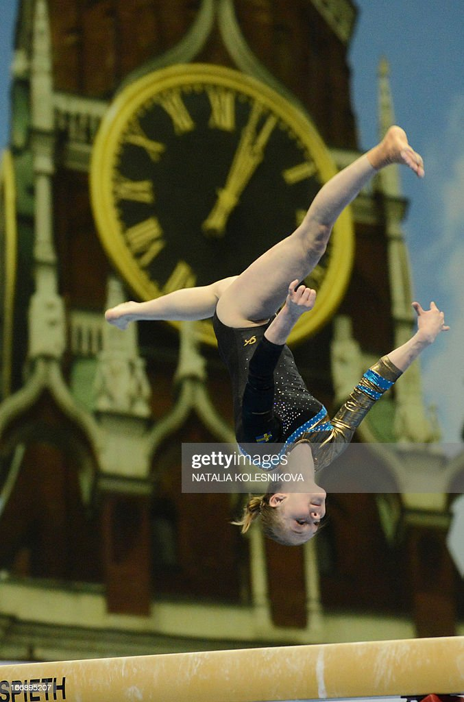 Sweden's Ida Gustafsson competes on the balance beam against a huge photo of the Kremlin's Spasskaya (Saviour) Tower during the women's individual artistic gymnastics qualification during the 5th European Men's and Women's Artistic Gymnastic Individual Championships in Moscow on April 18, 2013. The 5th European Men's and Women's Artistic Gymnastic Individual Championships takes place in Moscow from April 17 to April 21.