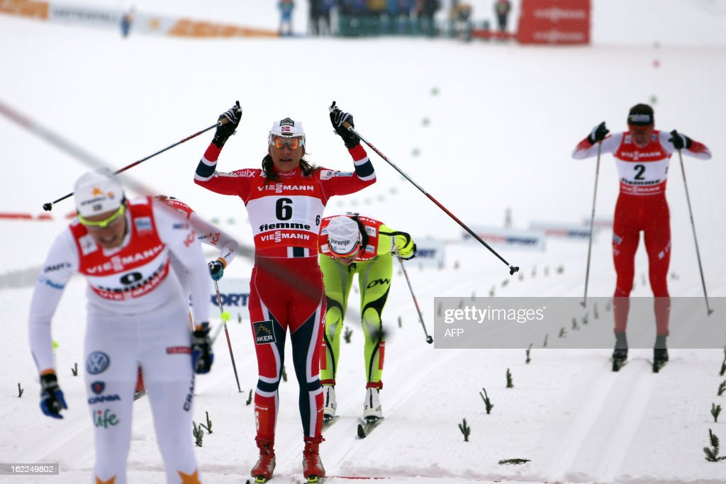 Sweden's Ida Ingemarsdotter (L), Norway's Maiken Caspersen Falla (C) and Poland's Justyna Kowalczyk (R) cross the finish line on February 21, 2013 of the Women's Cross Country 1.2km sprint final race of the FIS Nordic World Ski Championships at Val Di Fiemme Cross Country stadium in Cavalese, northern Italy.