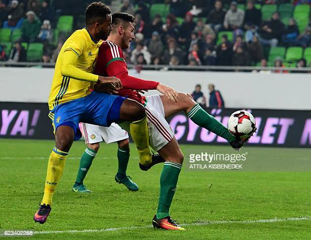 Sweden's Isaac Thelin fights for the ball with Hungary's Adam Pinter during the friendly football match Hunhgary vs Sweden in Budapest on November 15...