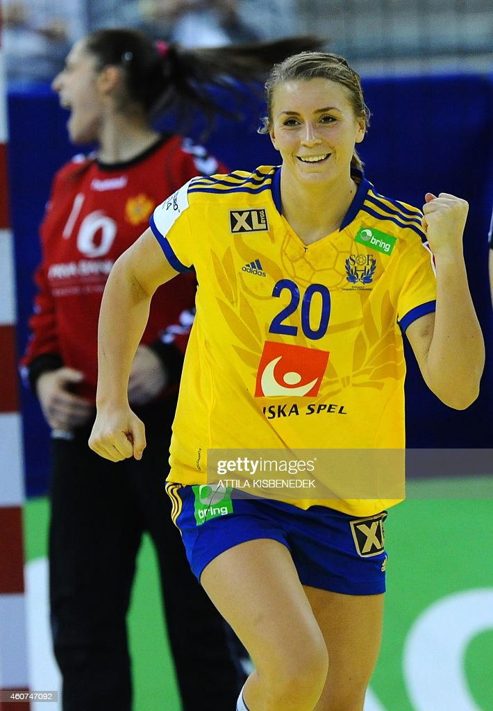 Sweden's Isabelle Gullden celebrates her score against Montenegro's goalkeeper Marina Vukcevic (L) during the bronze medal match of the Women's European Handball Championship on December 21, 2014 in Budapest.