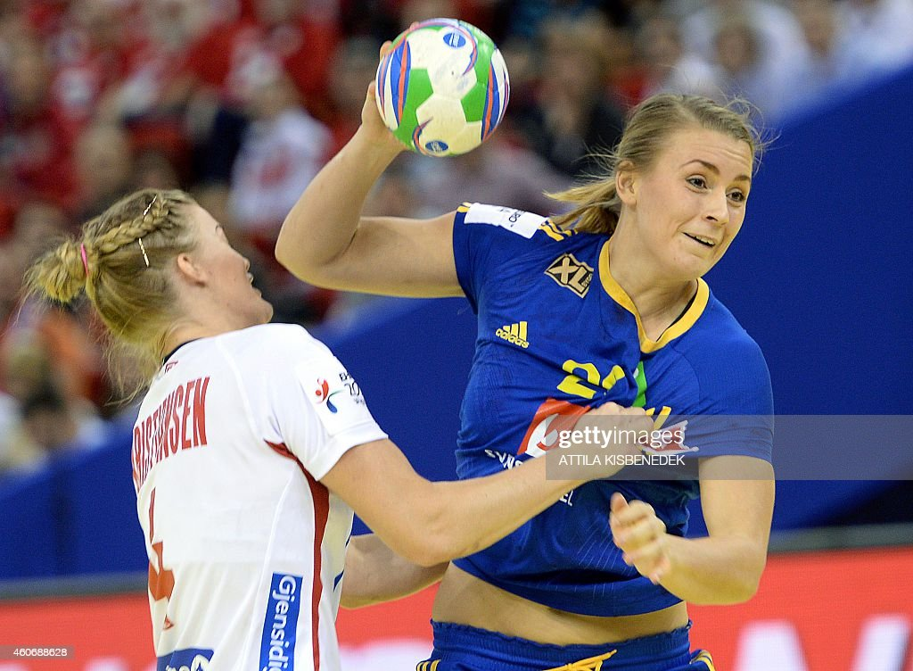 Sweden's <a gi-track='captionPersonalityLinkClicked' href=/galleries/search?phrase=Isabelle+Gullden&family=editorial&specificpeople=4651166 ng-click='$event.stopPropagation()'>Isabelle Gullden</a> (R) scores a goal against Norway's Veronica Kristiansen (L) in Papp Laszlo Arena of Budapest on December 19, 2014 during their semifinal match of Women's European Championships. AFP PHOTO / ATTILA KISBENEDEK