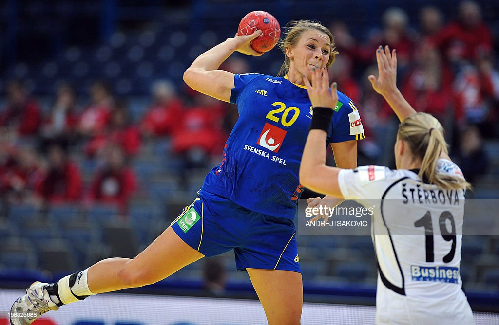 Sweden's Isabelle Gullden (L) vies for the ball with Czech's Helena Sterbova during the Women's EHF Euro 2012 Handball Championship match between Czech Republic and Sweden on December 13, 2012, at the Belgrade Arena.