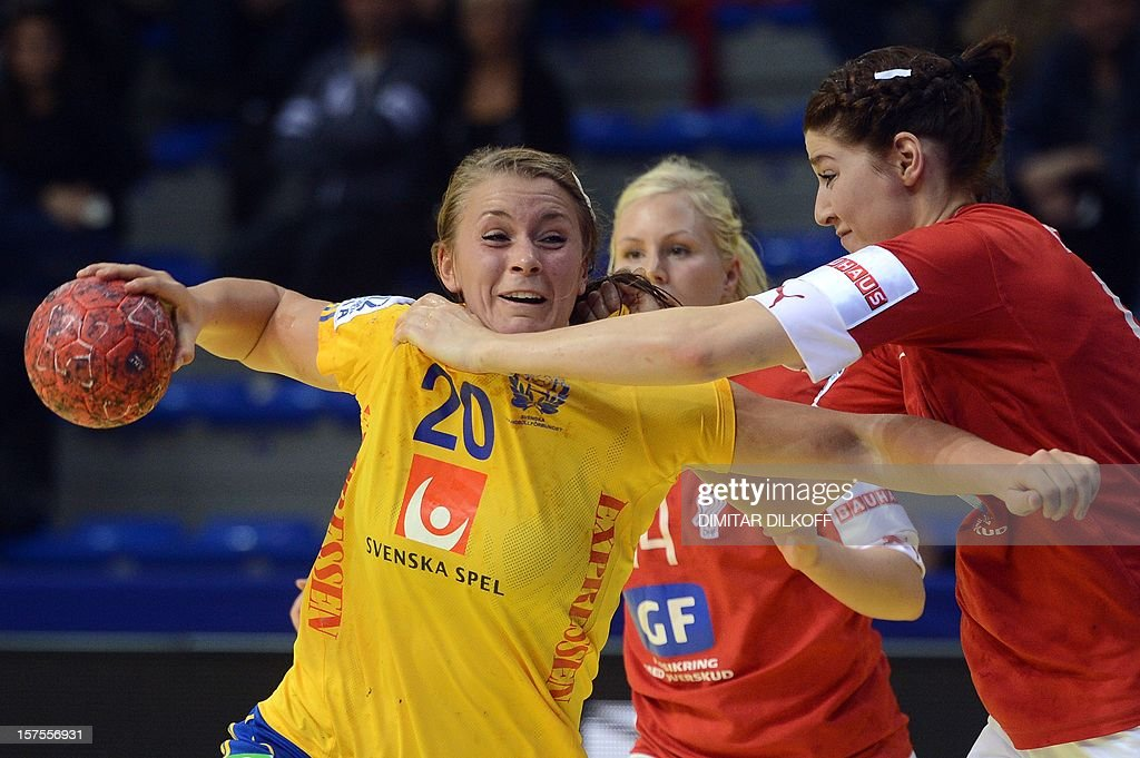 Sweden's Isabelle Gullden (L) vies for the ball with Denmark's Marianne Pedersen (R) during the Women's EHF Euro 2012 Handball Championship match between Sweden and Denmark in Nis on December 4, 2012.