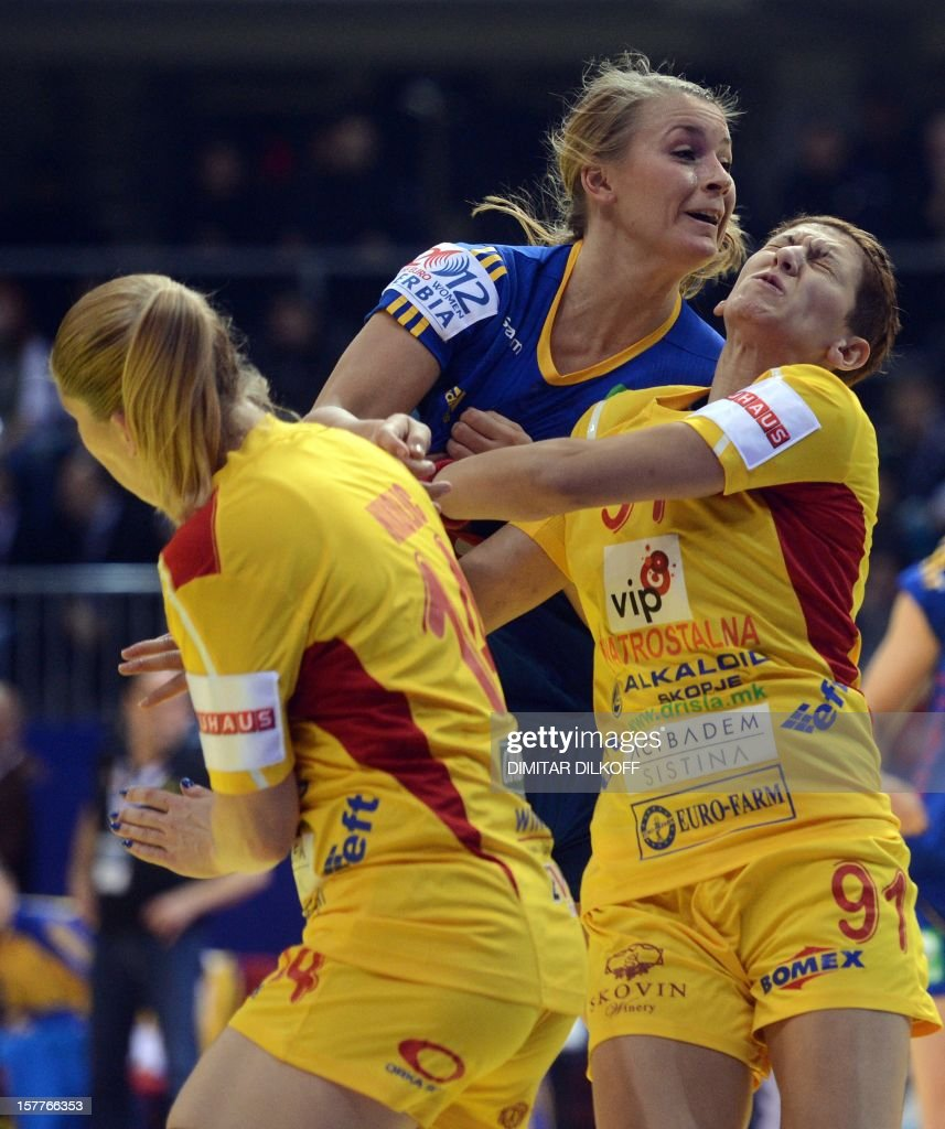 Sweden's Isabelle Gullden (C) vies with Macedonia's Julija Nikolic (L) and Marija Shteriova (R) during the Women's EHF Euro 2012 Handball Championship match between Macedonia and Sweden in Nis on December 6, 2012.